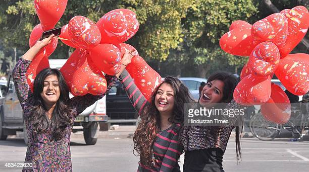 Relatives and friends enjoy with heart shaped balloons as they celebrated Valentine's Day on February 14 2015 in Panchkula India Valentine's Day also...