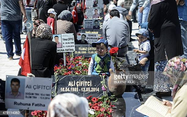 Relatives and friends gather at the cemetery in the Turkish town of Soma in the Manisa district, western Turkey, on May 13, 2015 to mark the first...