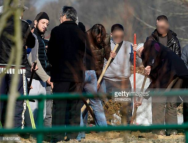 Relatives and friends including Abid Aberkan attend the burial ceremony of Brahim Abdeslam one of the attackers of the November 13 Paris attacks at...