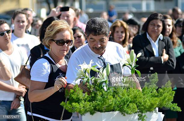 """Relatives and friends make honor to victims of flight JJ3054 at the """"Memorial 17 de Julho"""" in São Paulo Brazil, where the aircraft of TAM crashed and..."""
