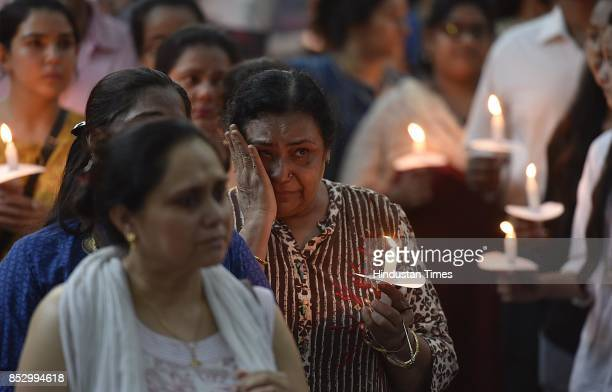 Relatives and friends mourn during a candle light march and protest for the justice to Late Dr Shashwat Pande a native of Allahabad and a resident of...