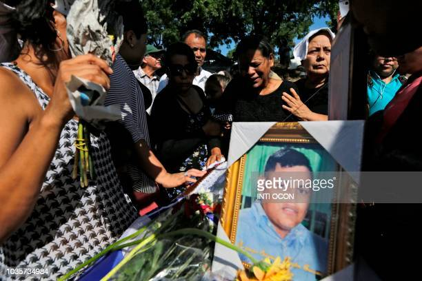 Relatives and friends mourn during the funeral of Ezequiel Leiva who died in the hospital three months after being injured during antigovernment...