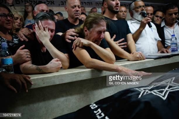 Relatives and friends mourn during the funeral of Kim Levengrond Yehezkel aged 28 one of the two Israeli nationals killed earlier in an attack on...