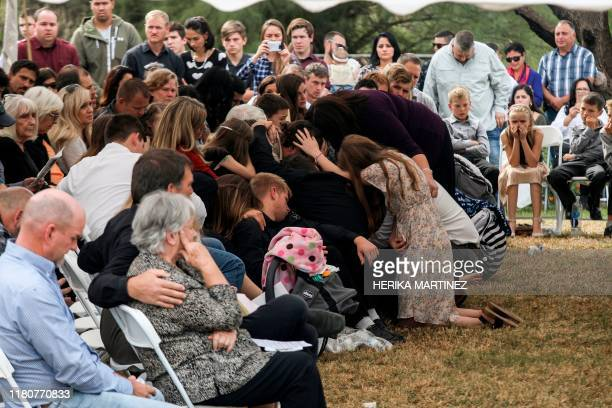 TOPSHOT Relatives and friends mourn during the funeral service of Dawna Ray Langford and her sons Trevor and Rogan who were among nine victims killed...