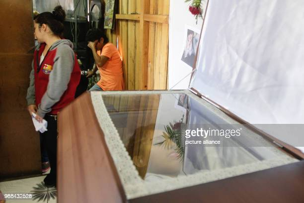 Relatives and friends of a 19year old mourning his death during a wake in Tegucigalpa Honduras 02 December 2017 According to witness reports the...