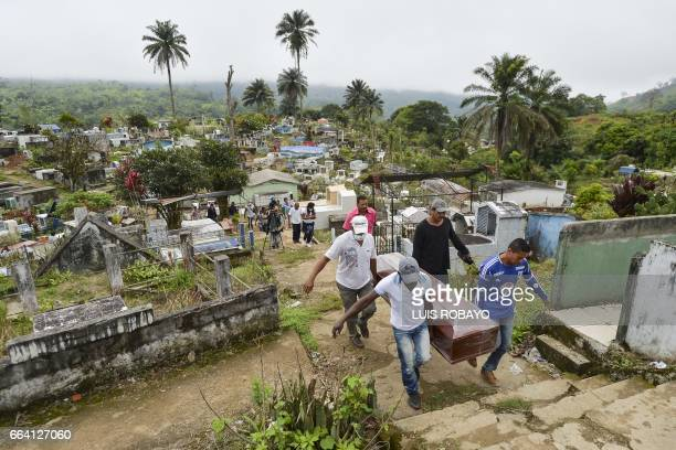 Relatives and friends of Anderson Guerrero carry his coffin during his funeral at a cemetery in Mocoa Putumayo department southern Colombia on April...
