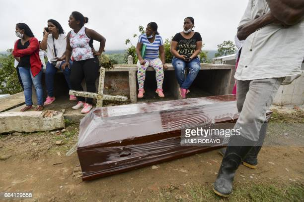 Relatives and friends of Anderson Guerrero remain waiting next to his coffin during his funeral at a cemetery in Mocoa Putumayo department southern...