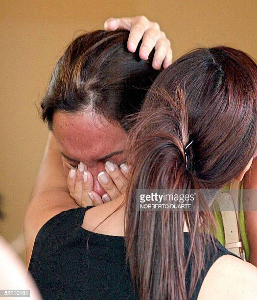 Relatives and friends of Cecilia Cubas daughter of former Paraguayan President Raul Cubas cry during her wake in Asuncion 17 February 2005 Five...