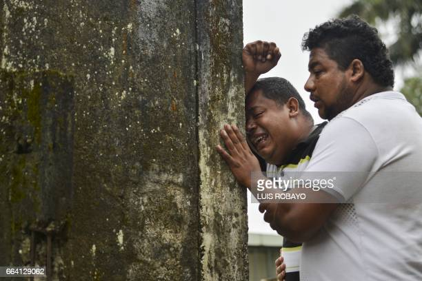 TOPSHOT Relatives and friends of Deisy Rosero mourn during her funeral at a cemetery in Mocoa Putumayo department southern Colombia on April 3 2017...