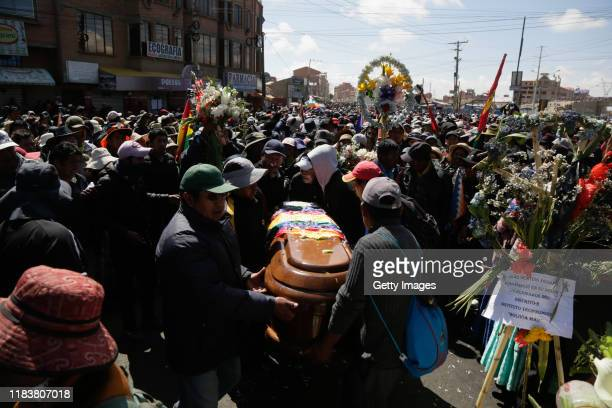 Relatives and friends of Devi Posto Cusi carry his coffin who was killed during clashes with police at the Senkata fuel plant as part of a funeral...
