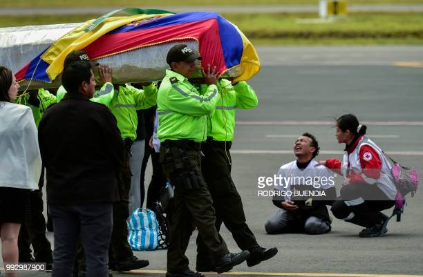 TOPSHOT Relatives and friends of Ecuadorean slain couple Katty Velasco and Oscar Villacis as police carry one of the coffins upon their arrival at...