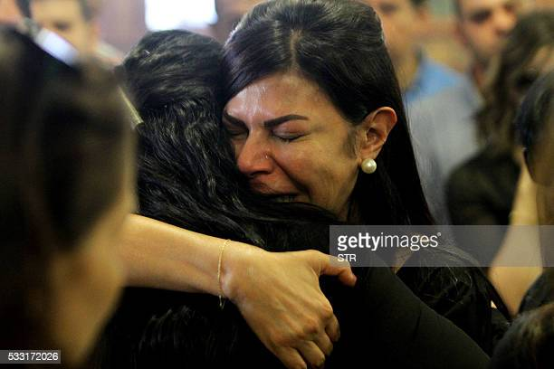 Relatives and friends of EgyptAir hostess Yara Hani who was onboard Flight MS804 from Paris to Cairo shortly before it plunged into the Mediterranean...