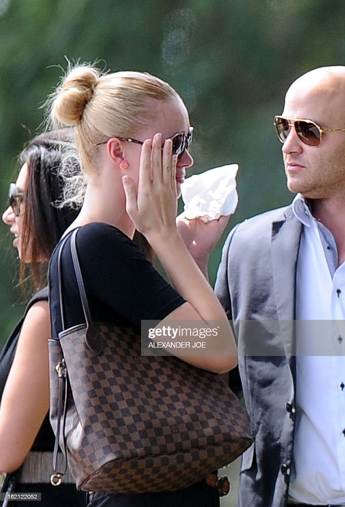 Relatives and friends of late South African model Reeva Steenkamp gather for the funeral ceremony at the crematorium building in Port Elizabeth on February 19, 2013. The 29-year-old law graduate and cover girl was gunned down four times on February 14, 2013 at the upmarket Pretoria home of the Olympic and Paralympic star Oscar Pistorius. South African prosecutors on February 19 told a bail hearing that Oscar Pistorius was guilty of 'premeditated murder' in the Valentine's Day killing of his model girlfriend at his upscale home.