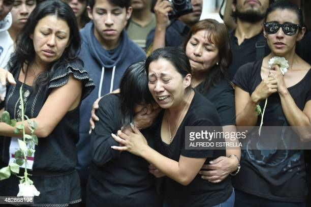 Relatives and friends of murdered Mexican photographer Ruben Espinosa mourn him upon arrival at the Dolores cemetery in Mexico City on August 3 2015...
