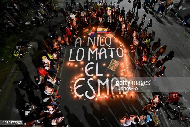 Relatives and friends of Nicolas Guerrero, who was killed during clashes with riot police at a protest against a tax reform bill, gather around...