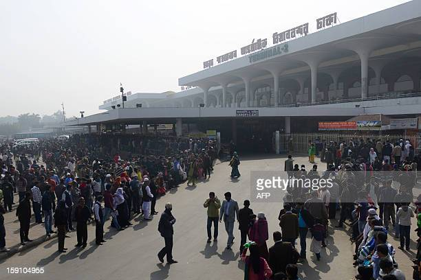 Relatives and friends of passengers wait outside Bangladesh's Hazrat Shahjalal International airport in Dhaka on January 8 2013 Flights at...