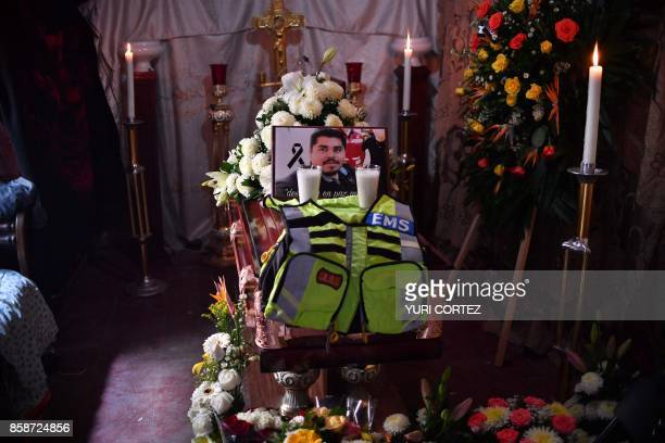 Relatives and friends of photojournalist Edgar Esqueda attend his wake in San Luis Potosi Mexico on October 7 2017 According to a report by Reporters...
