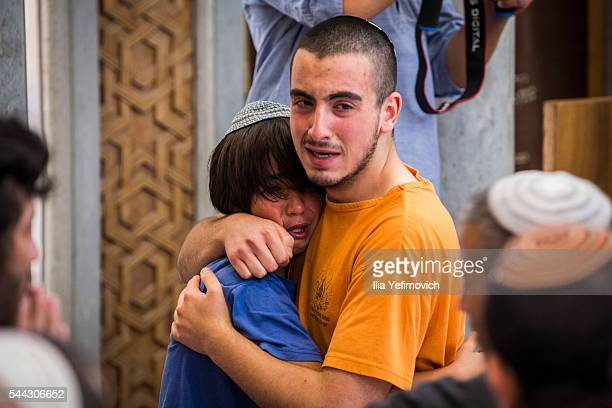 Relatives and friends of Rabbi Michael Mark mourn during his funeral on July 3 2016 in Otniel West Bank Rabbi Michael Mark was shot and killed and...