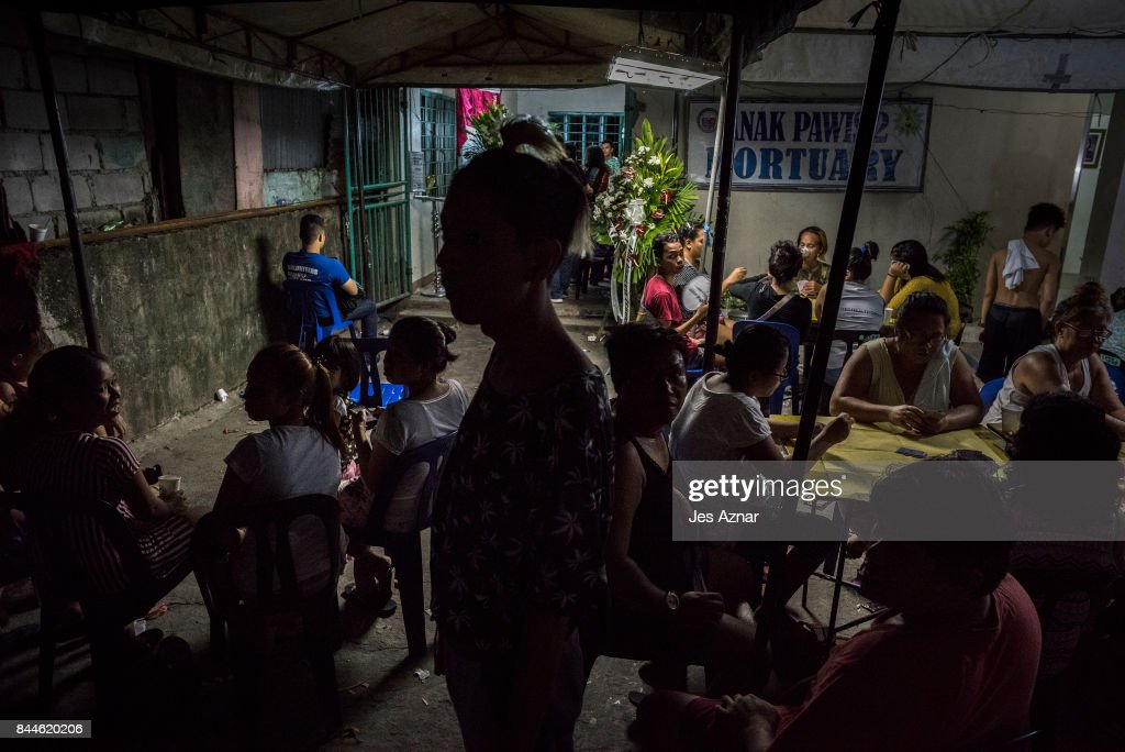 Relatives and friends of slain minor, Reynaldo de Guzman attend his wake on September 8, 2017 in Cainta City, Philippines. Outrage erupted as Philippine President Rodrigo Duterte's son Paolo Duterte, and son-in-law, Manases Carpio, are facing allegations that they helped facilitate a shipment of crystal methamphetamine worth $125.4 million into the country from China. All while killings related to the government's campaign against drugs continue and body counts continue to rise, recently including that of Reynaldo de Guman, a 14-year-old boy that was found with 30 stab wounds while his face was covered in packaging tape, in a waterway about 100 km north of Manila. Paolo Duterte reportly denied involvement as he told a senate inquiry that claims he helped ship drugs from China to the Philippines were 'baseless'.