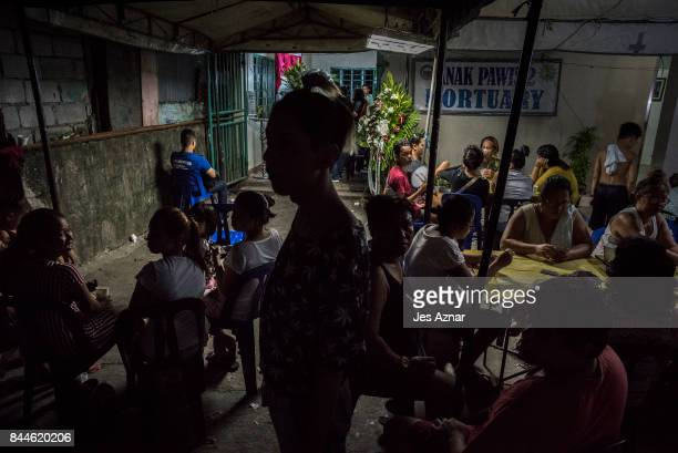 Relatives and friends of slain minor, Reynaldo de Guzman attend his wake on September 8, 2017 in Cainta City, Philippines. Outrage erupted as...