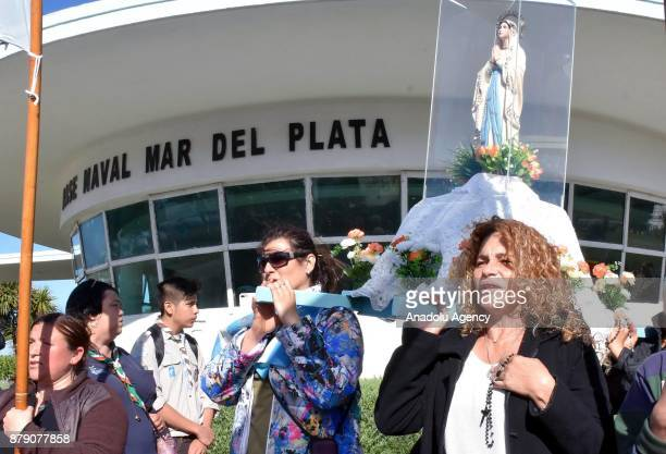 Relatives and friends of the crew of the submarine ARA San Juan pray in front of the Naval Base in Mar Del Plata Argentina on November 25 2017...