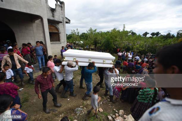 Relatives and friends of the family carry the coffin of Guatemalan sevenyearold Jakelin Caal who died in a Texas hospital two days after being taken...