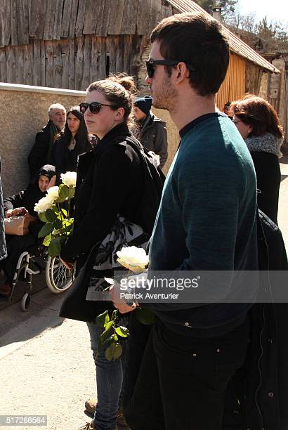 Relatives and friends of the victims lay flowers at the cemetery during the commemoration ceremony for the victims of the Germanwings plane crash on...