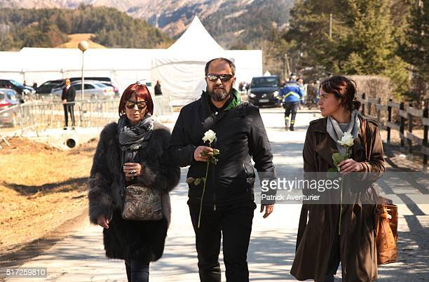 Relatives and friends of the victims place flowers at the memorial site during the memorial ceremony for the victims of the Germanwings plane crash...