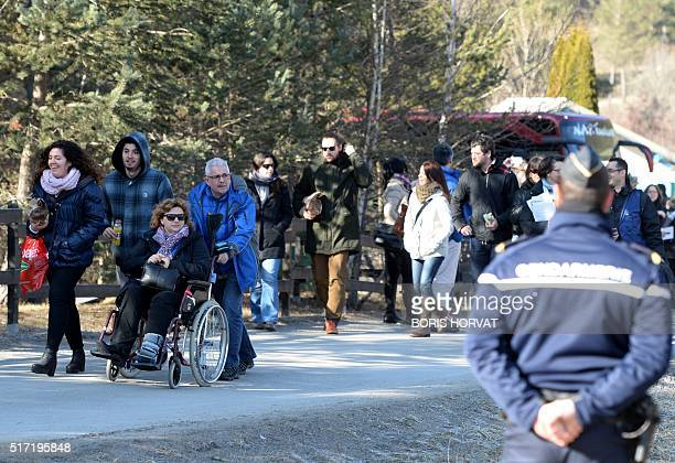 Relatives and friends of victims arrive for commemoration ceremonies at the memorial site in Le Vernet southwestern France on March 24 to mark the...