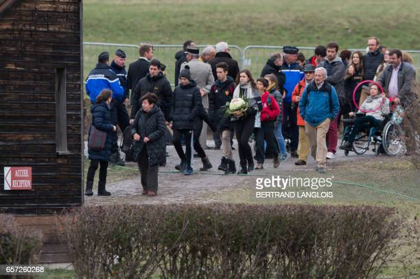 Relatives and friends of victims leave the commemoration ceremonies at the Vernet memorial southeastern France on March 24 2017 to mark the second...