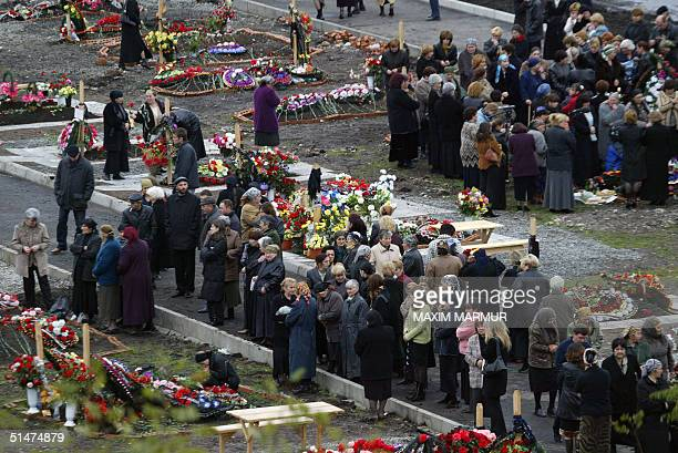 Relatives and friends of victims of the Beslan school siege mourn 13 October 2004 at the cemetery in the north Ossetian town This week marks the end...