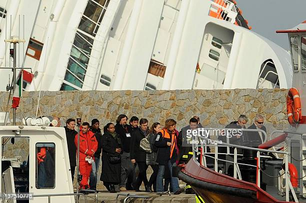 Relatives and friends of victims of the stricken cruise ship Costa Concordia arrive at Giglio Porto on January 19 2012 on the island of Giglio in...