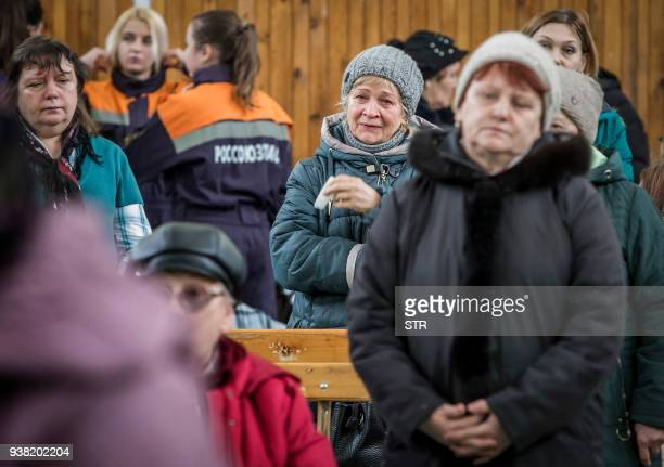 TOPSHOT Relatives and friends of victims who died during a fire at a multistory shopping center attend an Orthodox requium in Kemerovo in Kemerovo on...