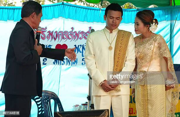 Relatives and friends speak during ceremonies at the wedding of Kanokporn and Montri Thi in Ta Par Mok Thailand Thai Buddhist marriage ceremonies are...