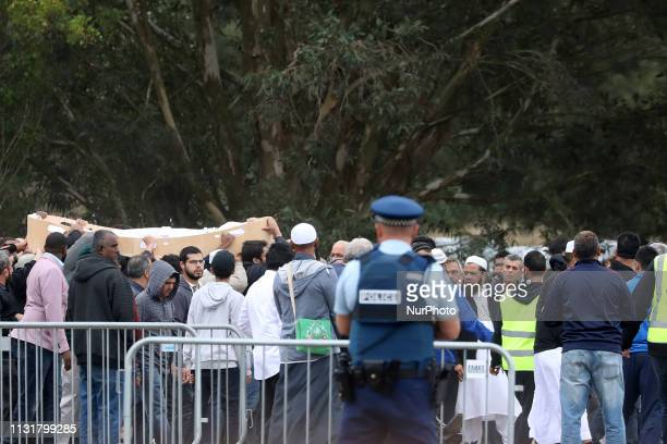 Relatives and mourners carry the body of a victim killed in Christchurch's mosque attacks at the Memorial Park Cemetery in Christchurch, New Zealand...