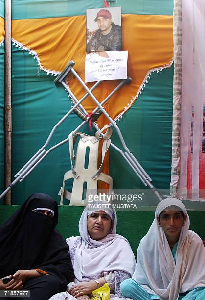 Relatives and neighbours of Innayatullah Bhat a physically challenged youth allegedly shot dead by Indian federal police in Kashmir's summer capital...