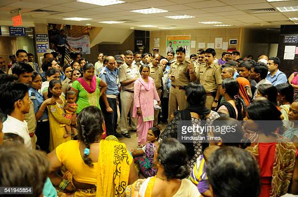 Relatives and neighbours of Sangeeta Devi stage protest at government district hospital on June 21, 2016 in Noida, India. The family of Sangeeta...