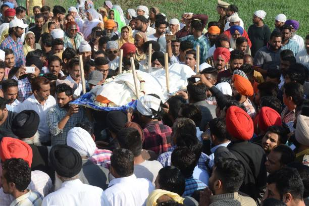 Relatives and residents carry the body of Sufi singer Pyare Lal Wadali at a cremation ground on the outskirts of Amritsar on March 9 2018 Famous Sufi.