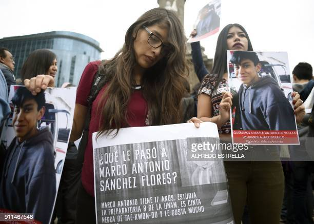 Relatives and students hold posters reading What happened to Marco Antonio Sanchez as they protest against the disappearance of student Marco Antonio...