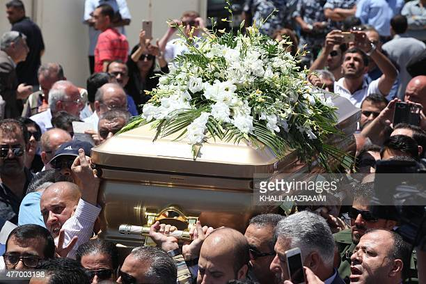 Relatives and supporters of Iraq's former foreign minister Tareq Aziz carry his coffin outside a church in the Jordanian city of Madaba some 35...