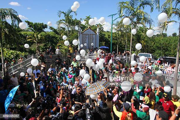 Relatives and supporters of the victims of the infamouse Maguindanao massacre including Philippine Justice Secretary Leila de Lima release white...
