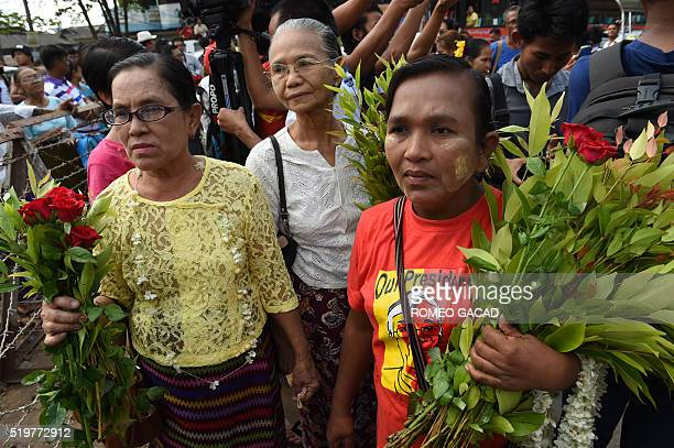 Relatives and sympathisers of political prisoners wait outside Insein prison in Yangon on April 8, 2016. A Myanmar court in nearby Tharrawaddy town...