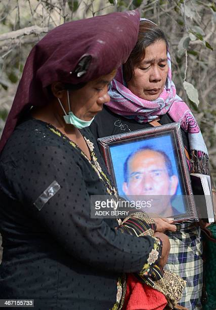 Relatives attend a funeral for Doni Meliala a victim of volcanic eruptions from mount Sinabung at Gurki Nayan village about 45 km from Sinabung's...