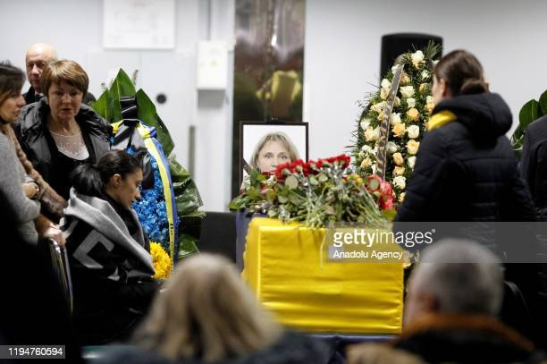 Relatives attend a honoring ceremony of the victims in the plane crash in Iran, at the Boryspil Airport in Kiev region, Ukraine, on January 19, 2020....