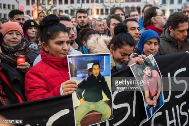 Relatives attend a vigil for the vicitims near the Midnight shisha bar one of the sites of last night's shootings on February 20 2020 in Hanau...