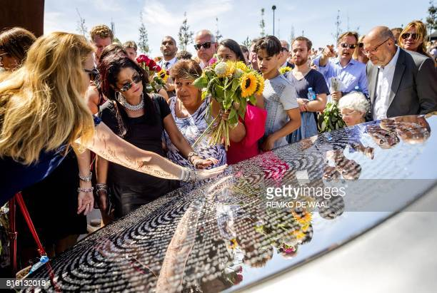 TOPSHOT Relatives attend the unveiling of the National Monument for the MH17 victims in Vijfhuizen on July 17 2017 Three years after Flight MH17 was...