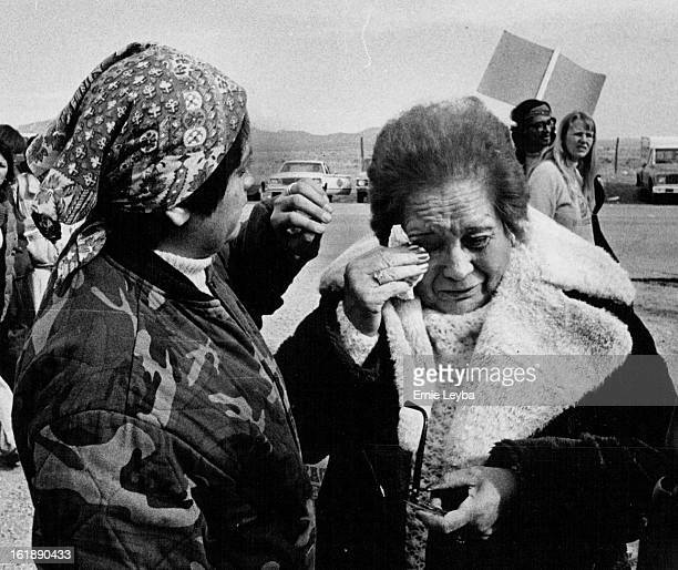 FEB 3 1980 FEB 4 1980 Relatives Await Word outside the gates of the new Mexico state Penitentiary Trine Garcia left and Jennie Cortez are concerned...