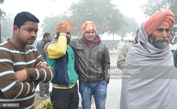 Relatives bemoan the death of 55yearold Sarabjit Kaur who succumbed to swine flu on January 20 2015 in Amritsar India Sarabjit Kaur an Amritsar...