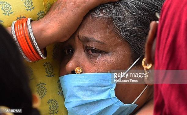 Relatives break down as they come to last rites of Covid victims at Ghazipur cremation ground, on April 20, 2021 in New Delhi, India.