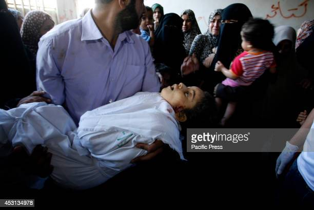 Relatives carry the body of a girl during the funeral of at least 9 members of the same alGhul family who died after their house was hit by an...